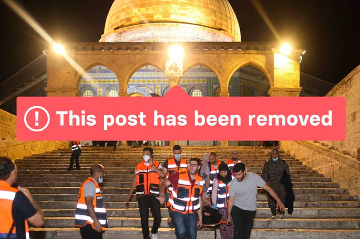 """A photo of Palestinian medics evacuate a wounded person during clashes between Israeli security forces and Palestinian protesters in Jerusalem's Al-Aqsa Mosque compound on May 10, 2021, with the words """"This post has been removed"""" overlayed"""