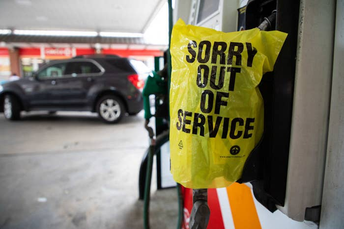 """A gas pump with a bag that says """"Sorry out of service"""""""