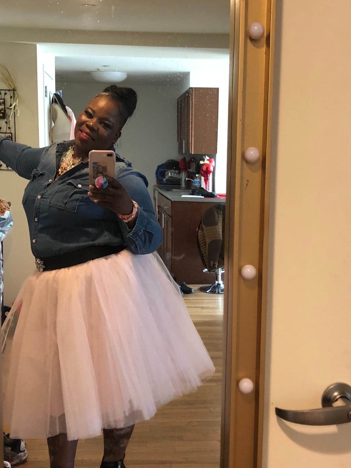 reviewer takes selfies wearing pink tulle skirt