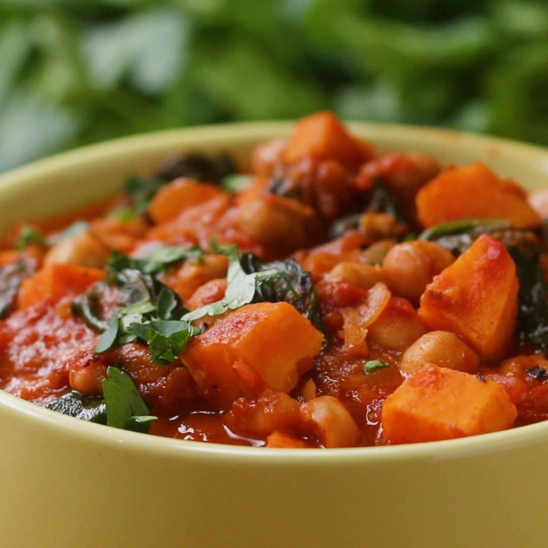 Pot of tomato-based soup with chickpeas