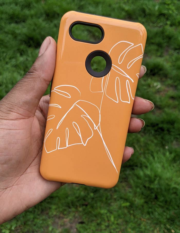 A person holding a phone case
