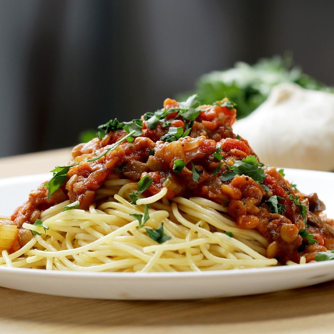 Plate of pasta covered in red sauce