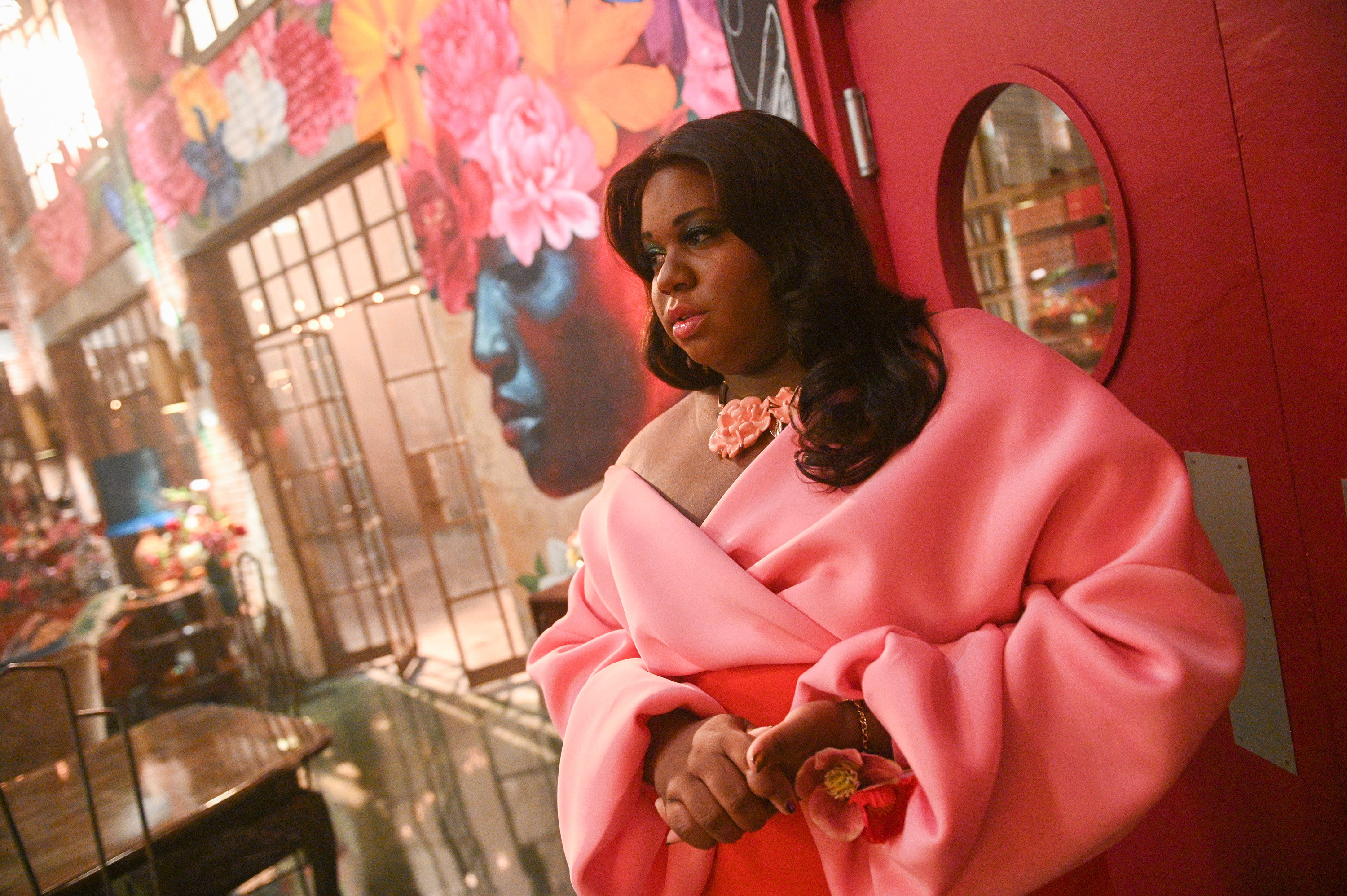 Alex Newell in a pink gown
