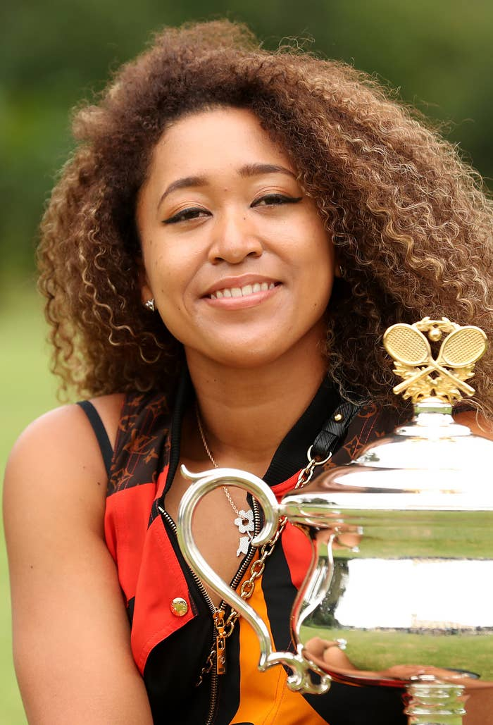 Naomi Osaka of Japan poses with the Daphne Akhurst Memorial Cup after winning the 2021 Australian Open Women's Final, at Government House on February 21, 2021, in Melbourne, Australia
