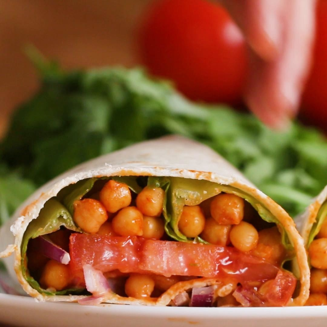 Tortilla wrap filled with veggies and chickpeas