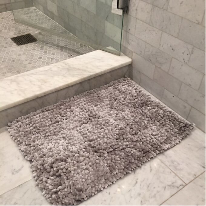 a reviewer's gray chenille rug