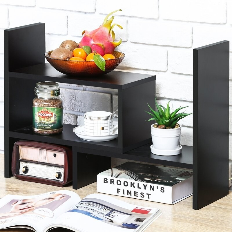 black organizer with decor of various colors