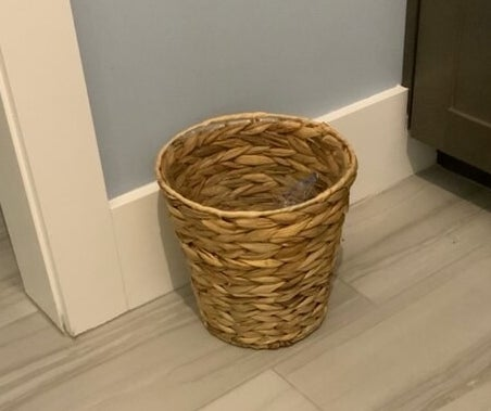 a reviewer's wicker trashcan