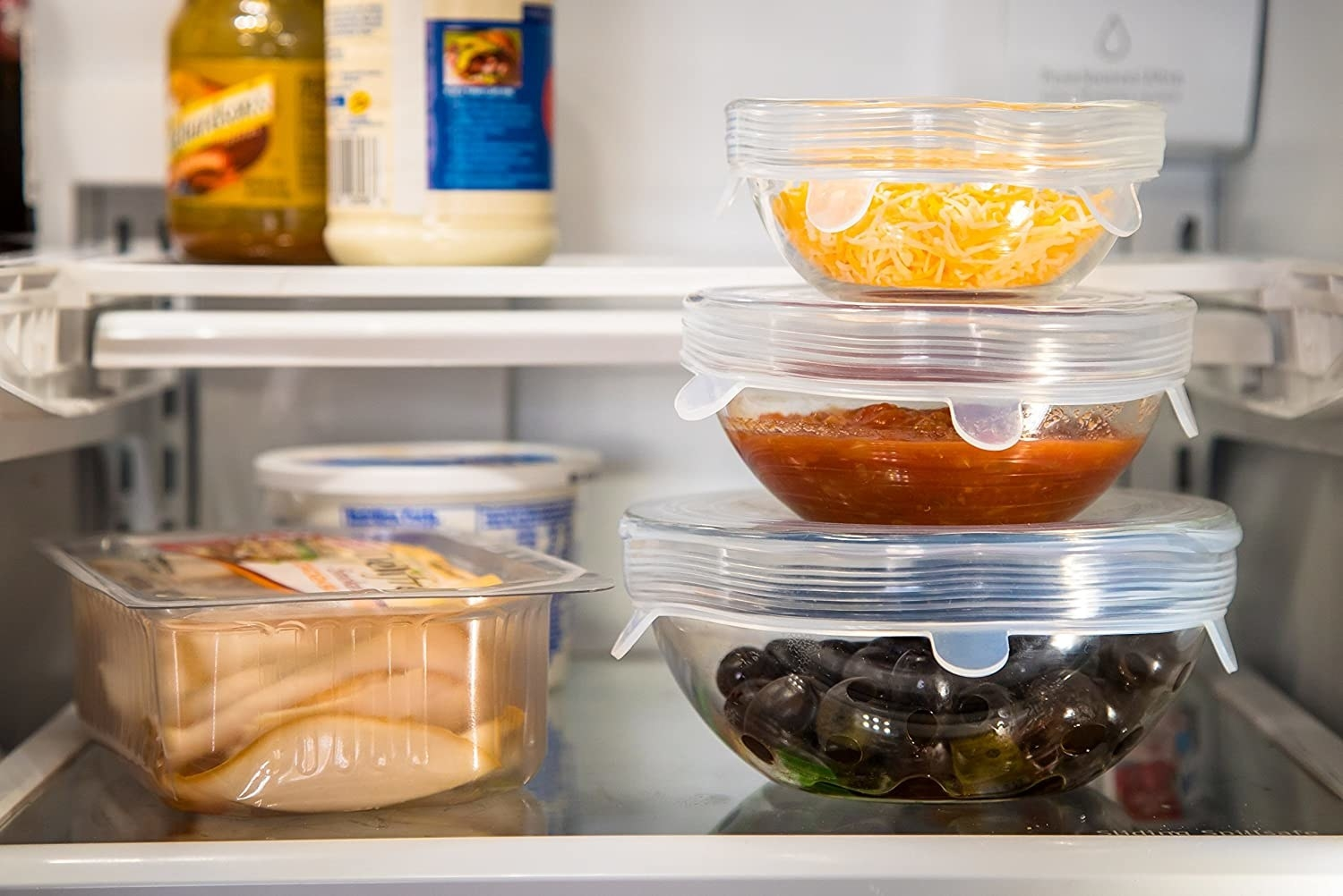 the silicone lids over bowls of leftovers