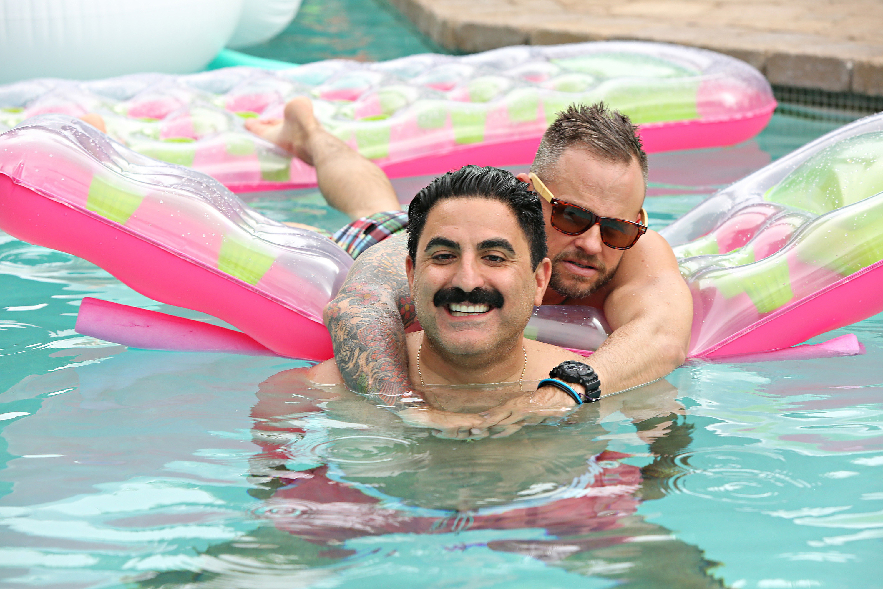 Reza Farahan and Adam Neely in a swimming pool