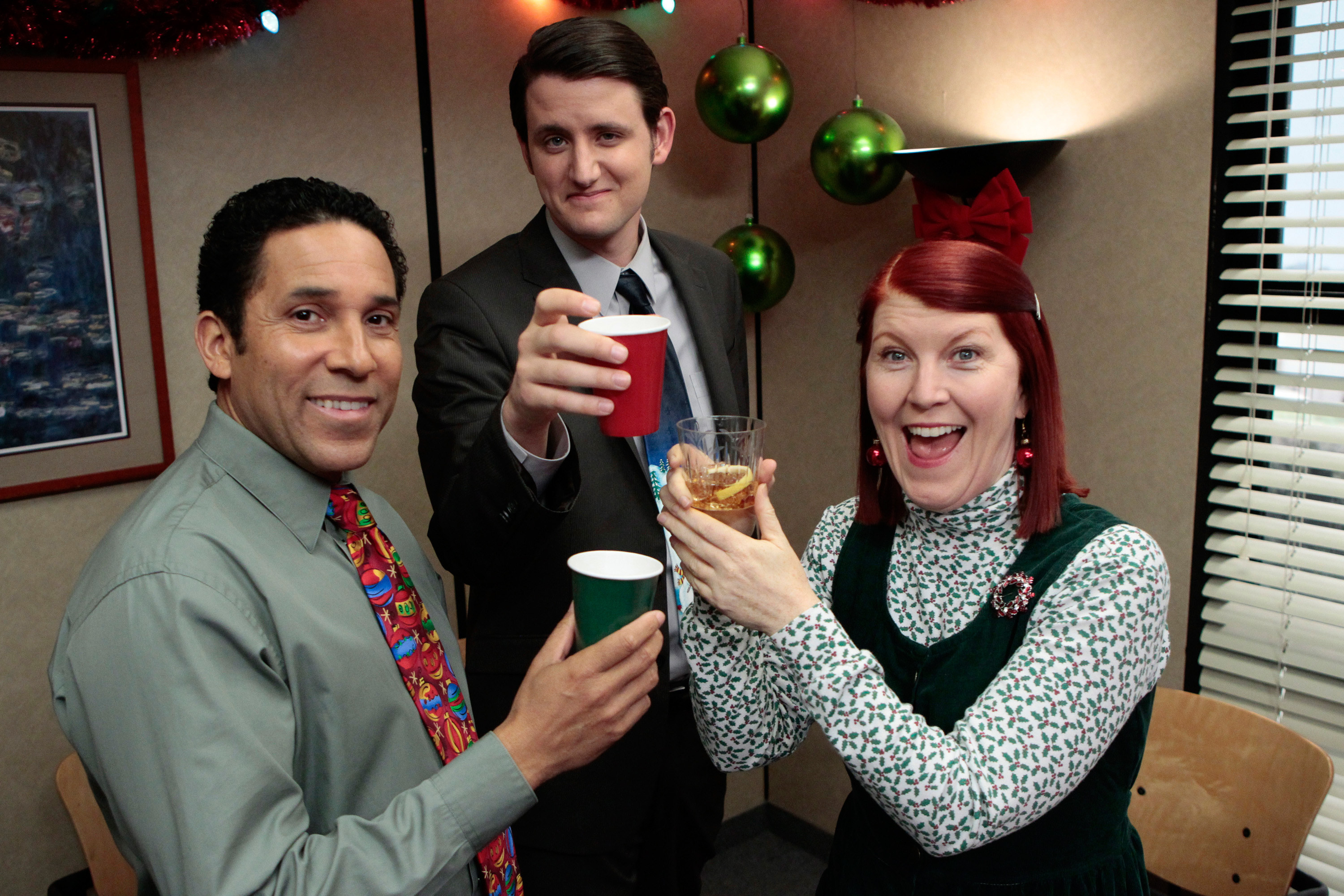 Oscar Nunez, Zach Woods, and Kate Flannery at a holiday party