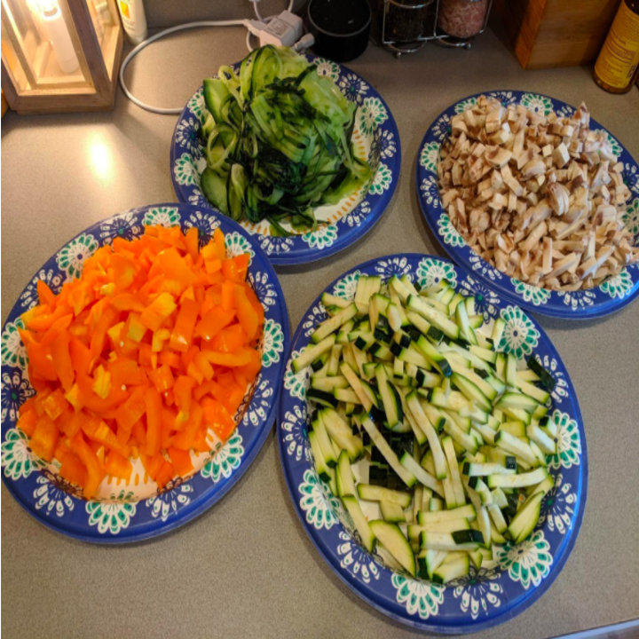a reviewer photo of uniformly chopped squash, peppers, and mushrooms