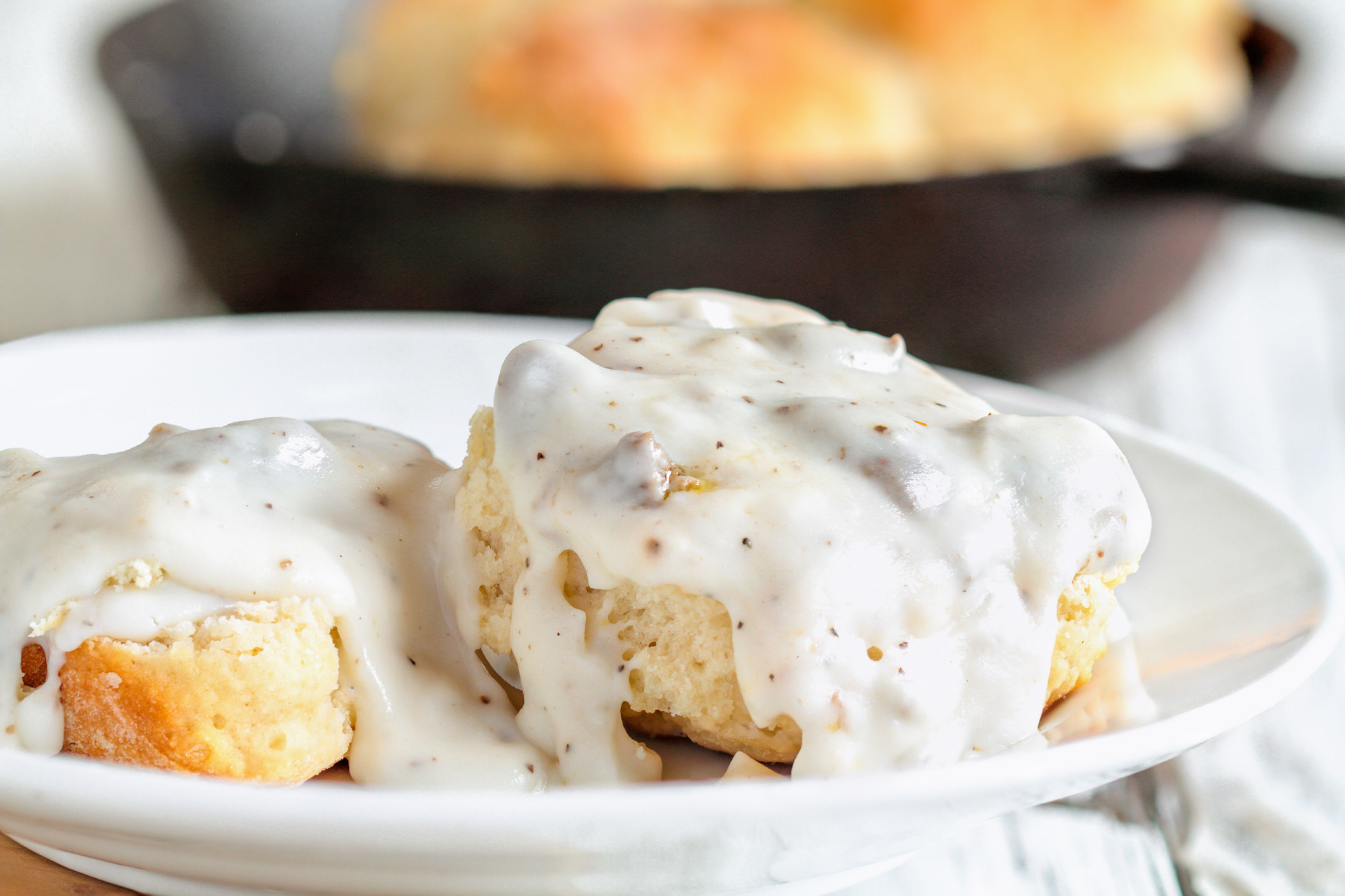 Two biscuits topped with gravy.