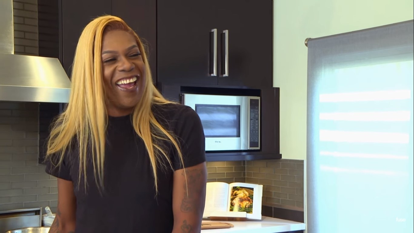 Big Freedia laughing in a kitchen
