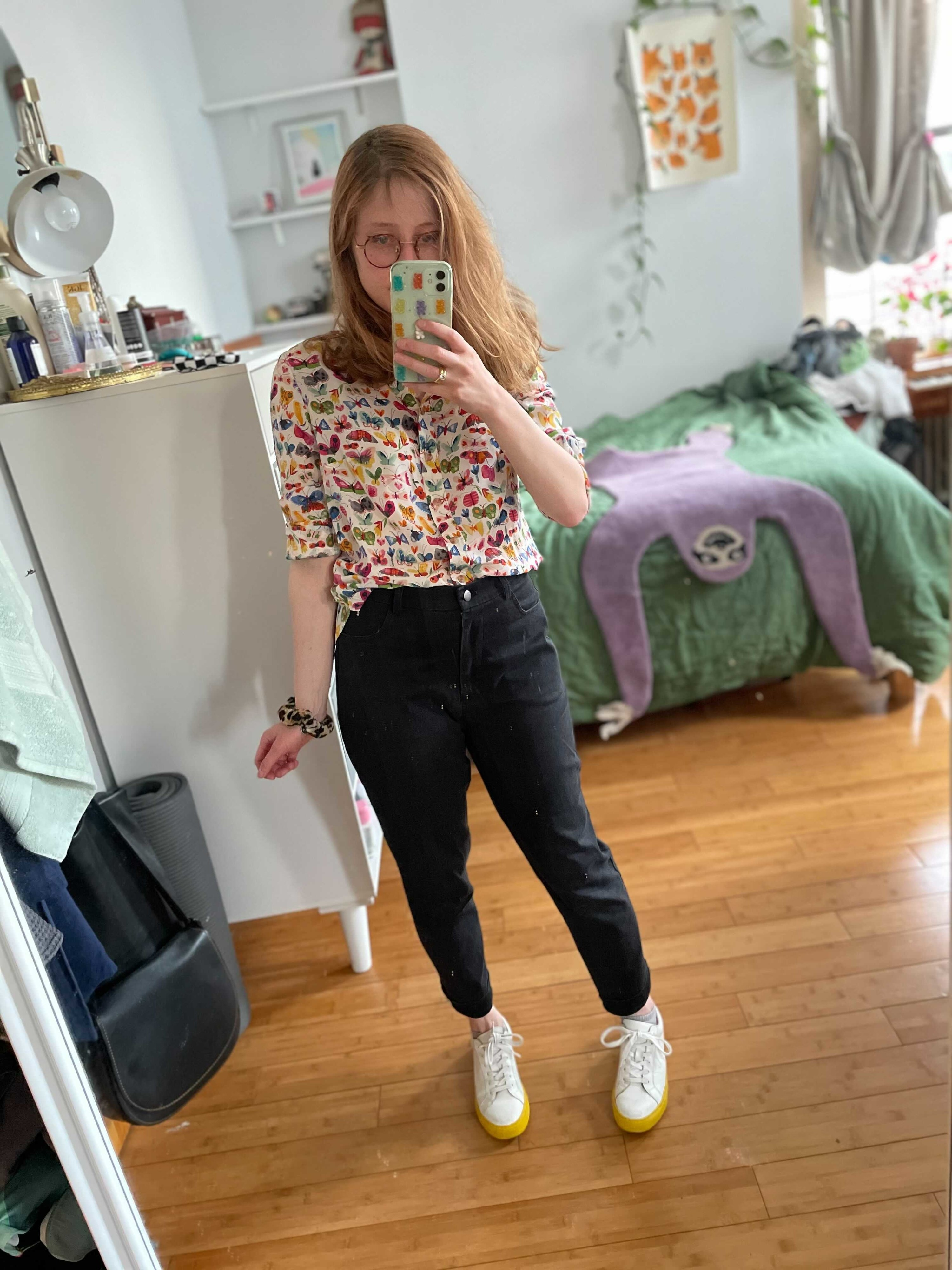 BuzzFeeder Bek wearing straight leg black jeans