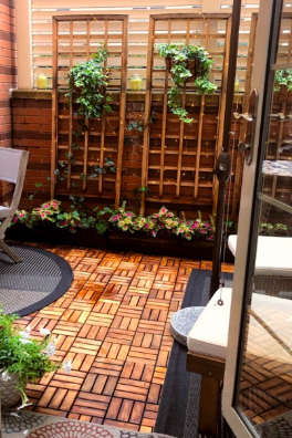 Backyard patio covered with the tiles