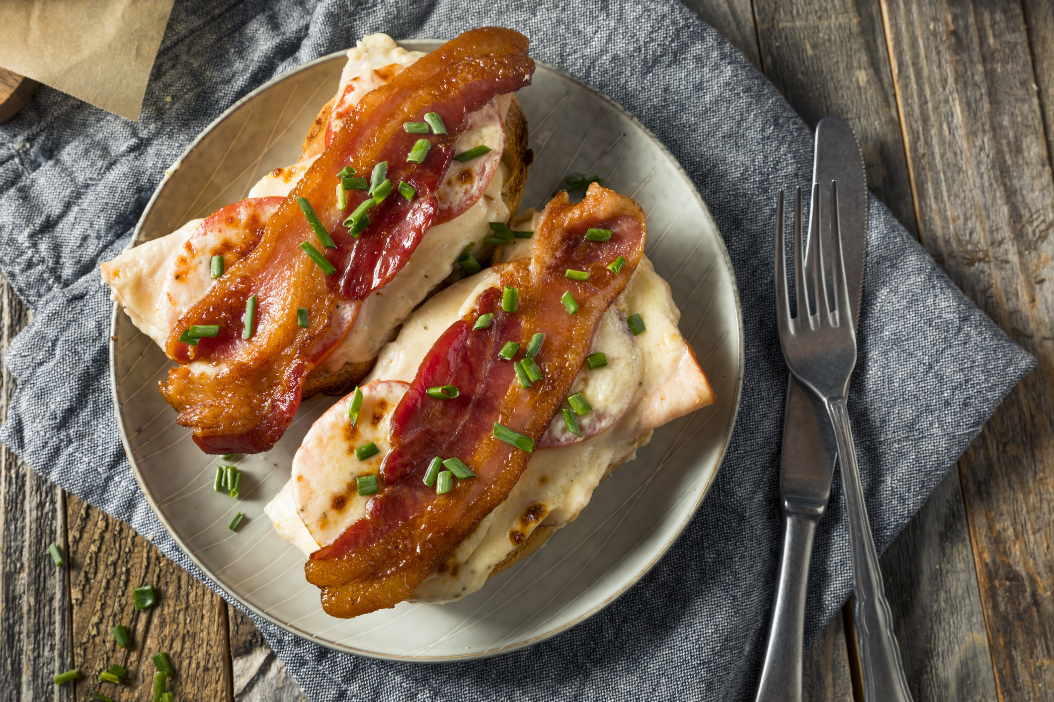 A Kentucky hot brown topped with bacon.