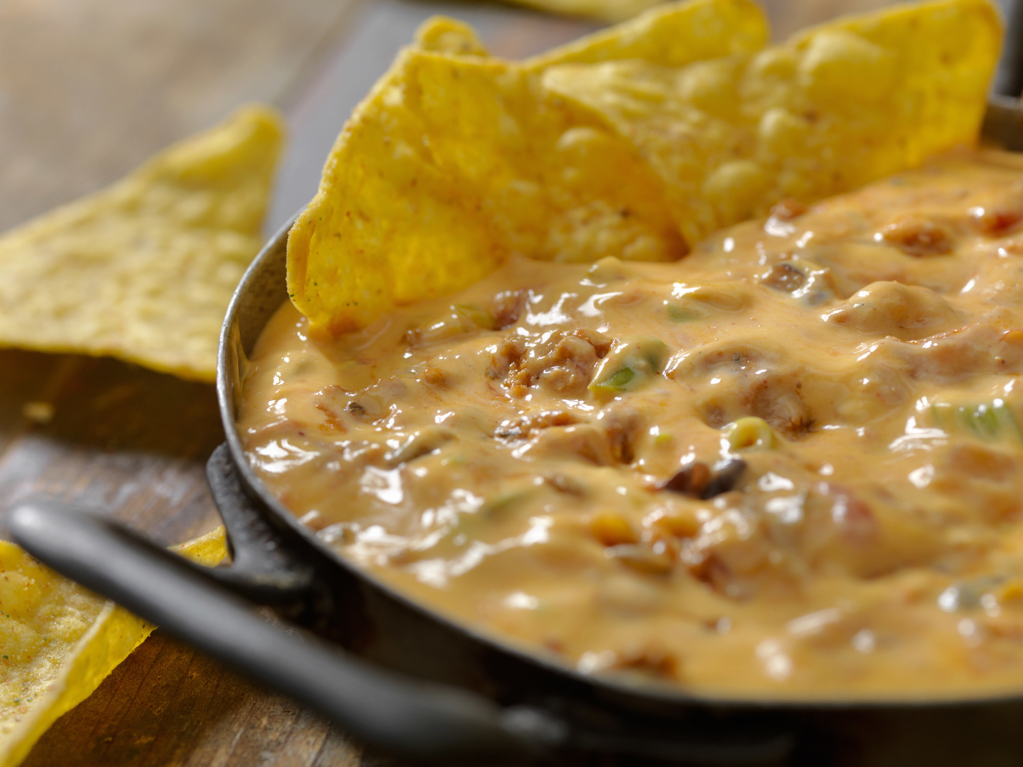 Cheese dip with tortillas chips.
