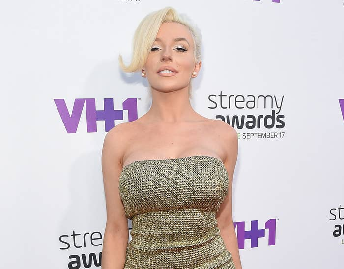 Courtney wears a gold strapless gown to an event