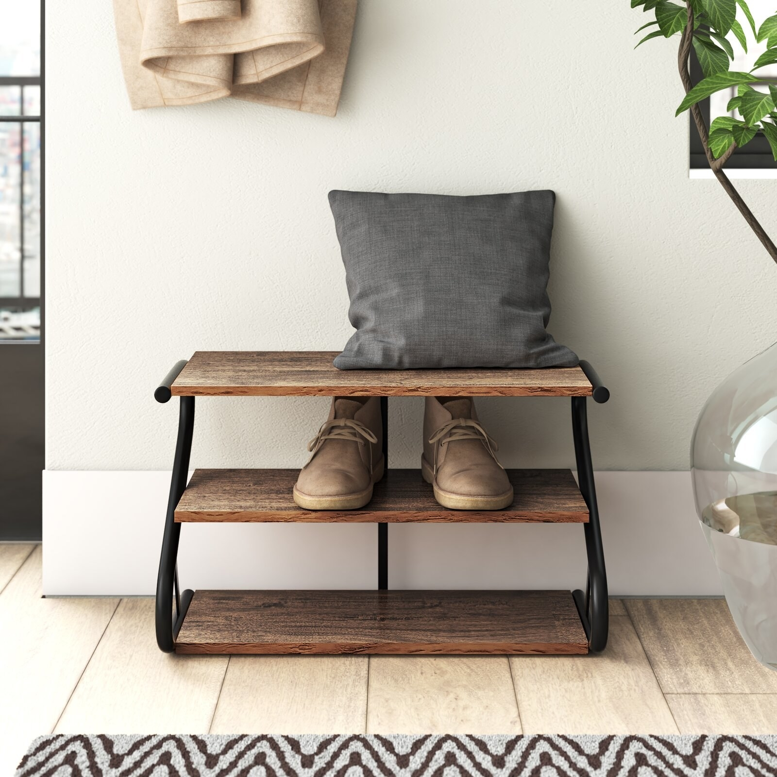 the 3-tier rustic rack with a pillow on the top rack, a pair of shoes in the middle, and nothing on the bottom
