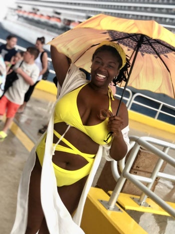 Reviewer wearing the bright yellow swimsuit