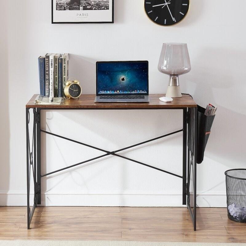 Brown desk with black legs