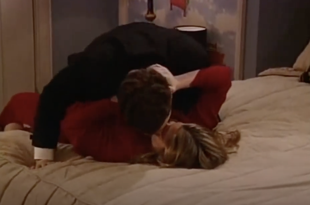 Corey and Topanga kissing on a hotel bed