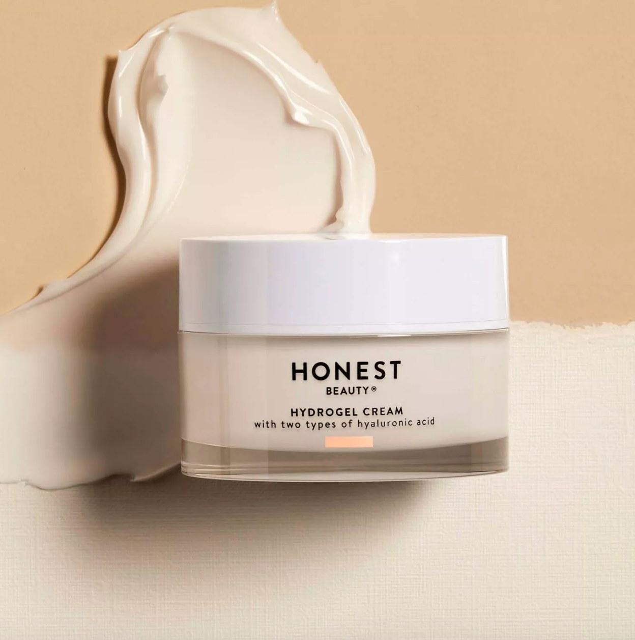 Honest Beauty moisturizer against cream background