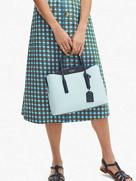model holding the purse
