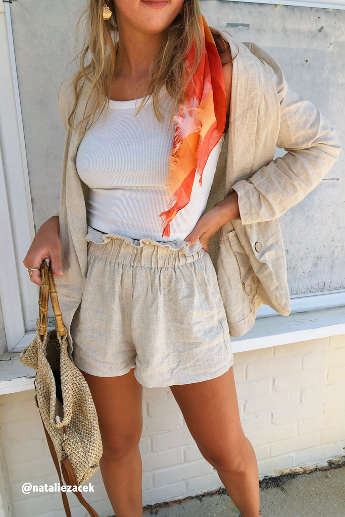 model wearing the nude linen shorts