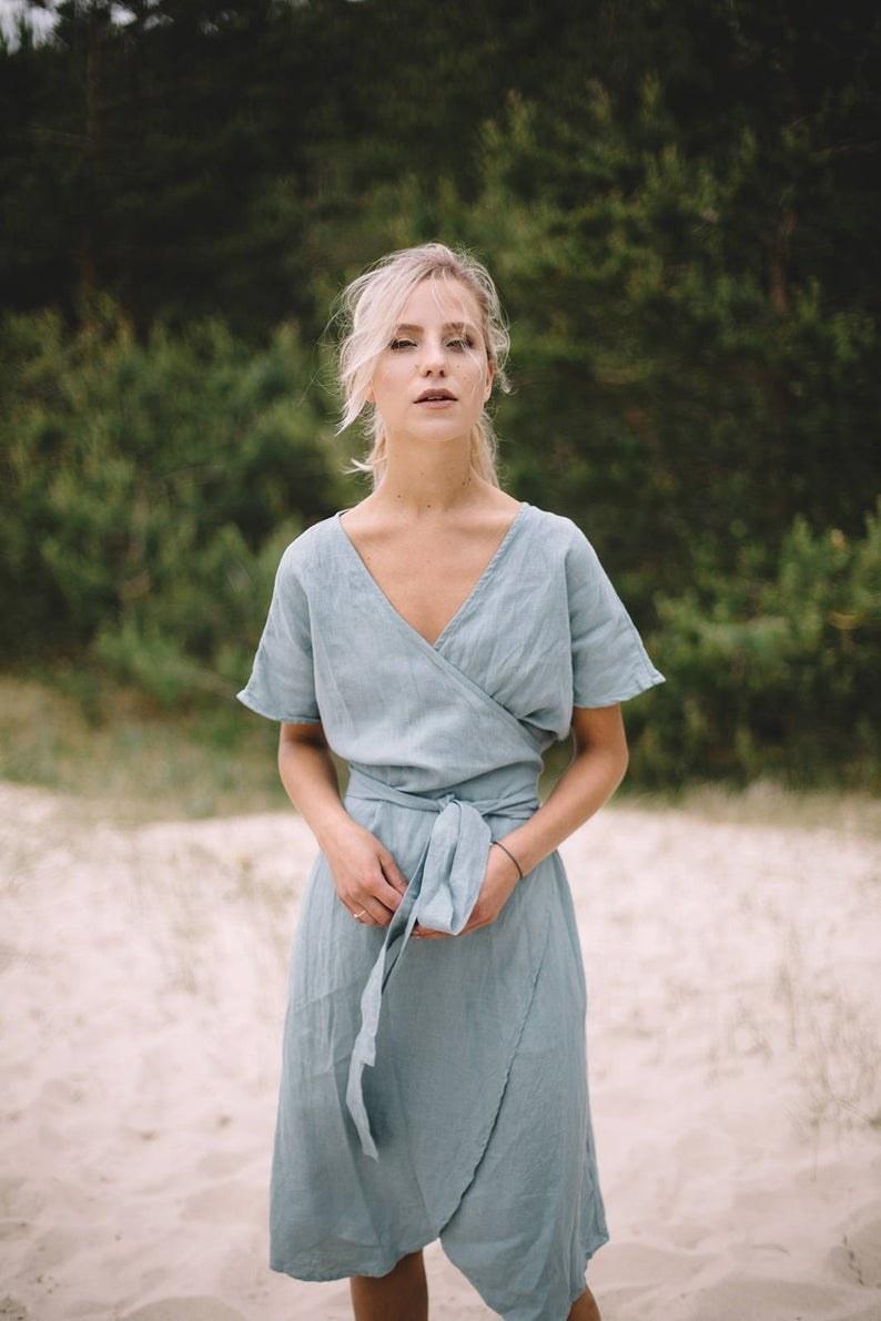 model wearing the short-sleeved wrap dress in light blue