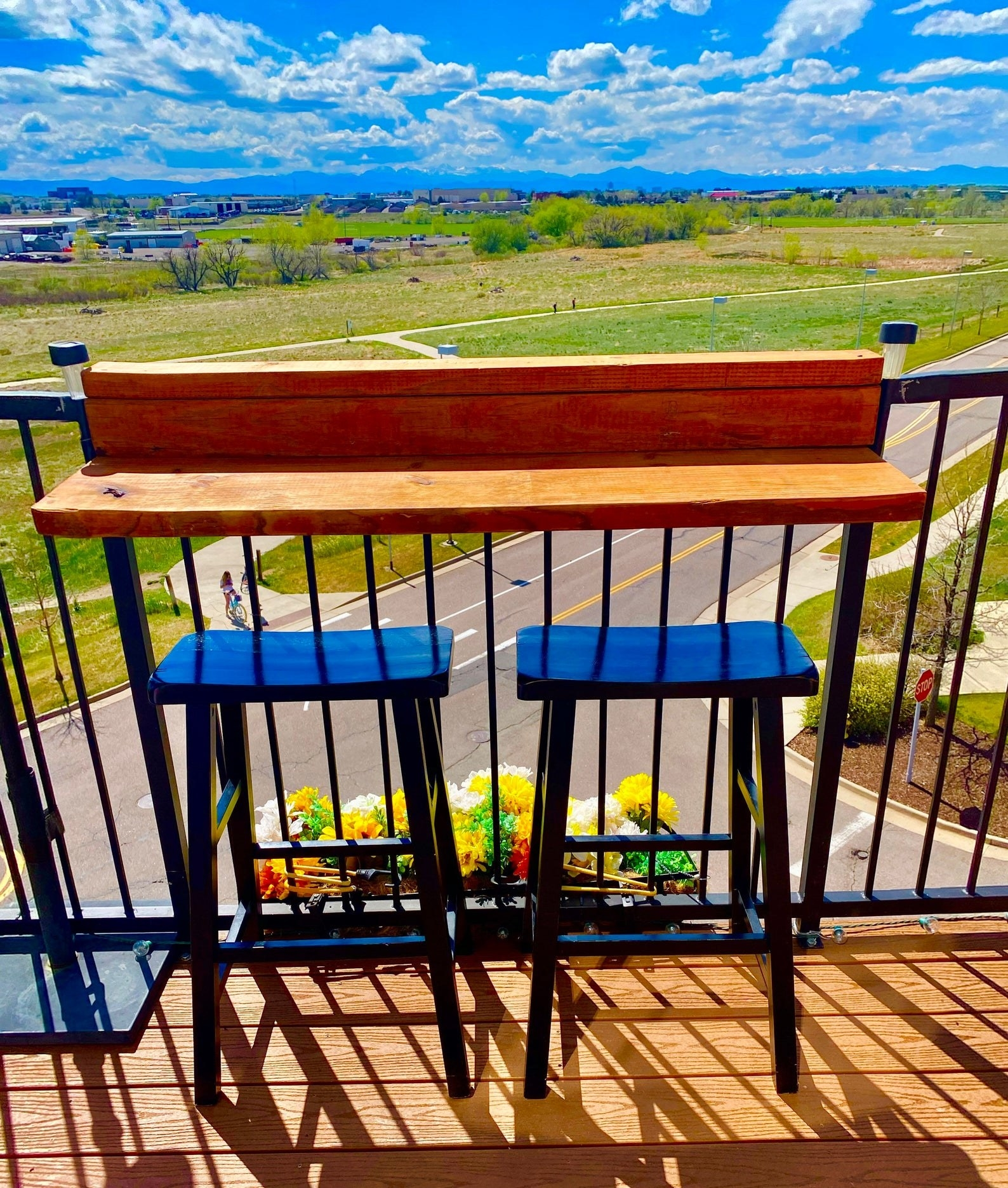 The wood bar attached to balcony railing