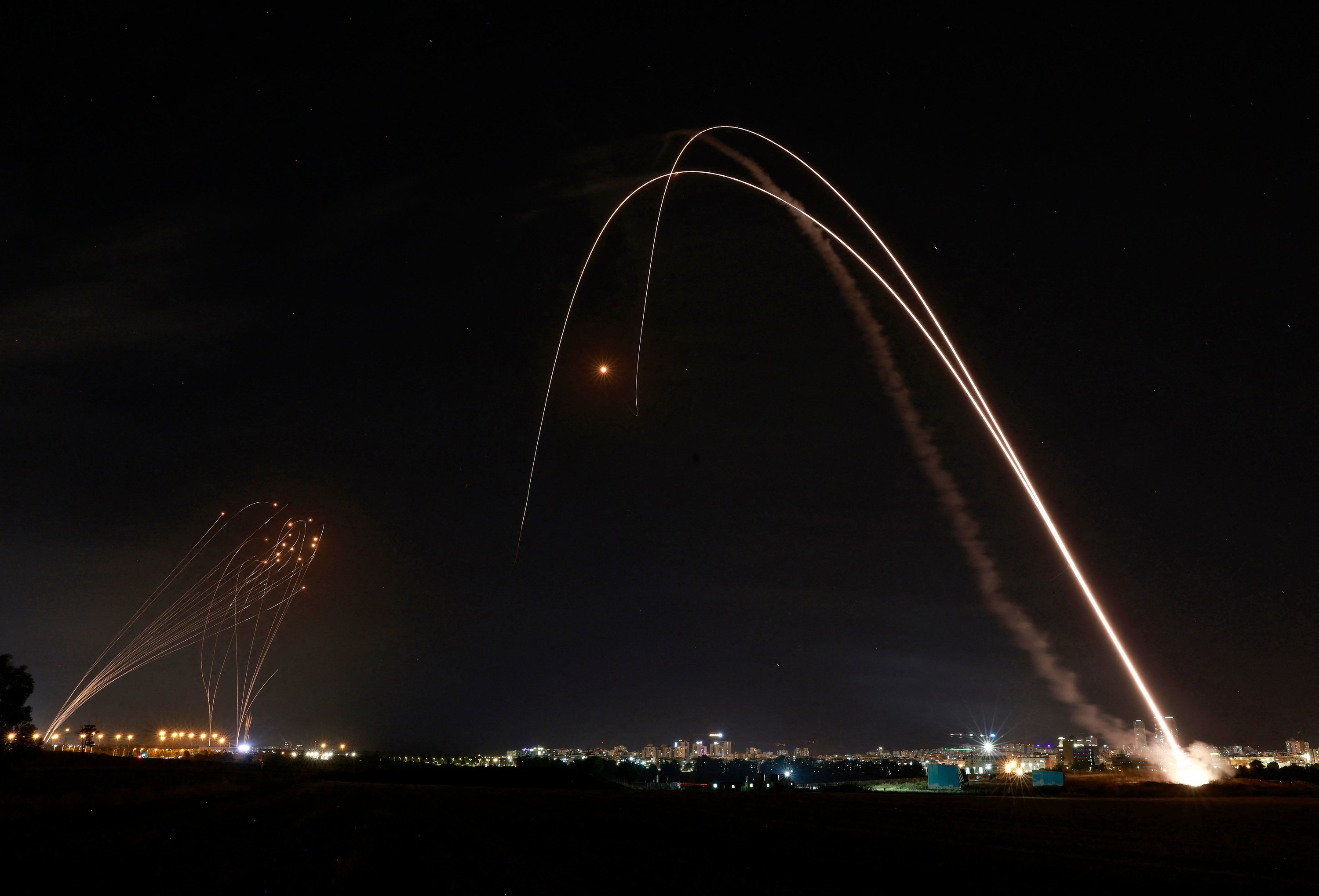 Rockets are launched over the night sky above the southern Israeli city of Ashdod