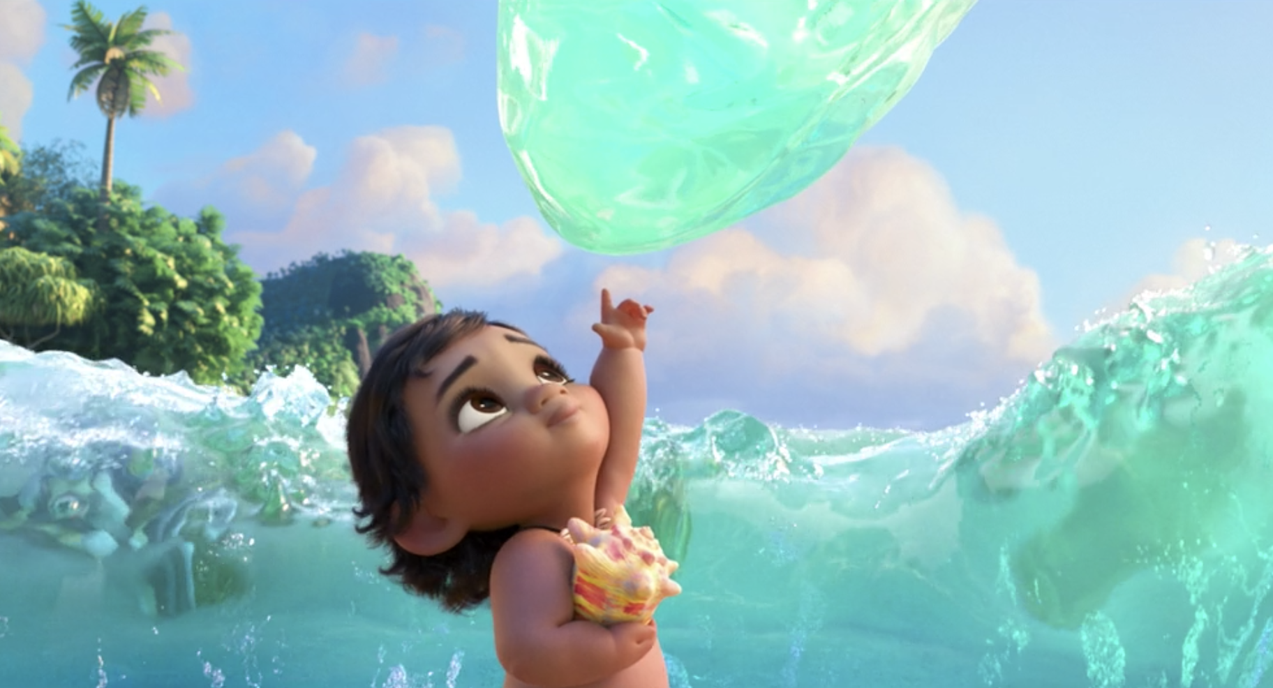 Moana touching the ocean, which is hanging over her magically