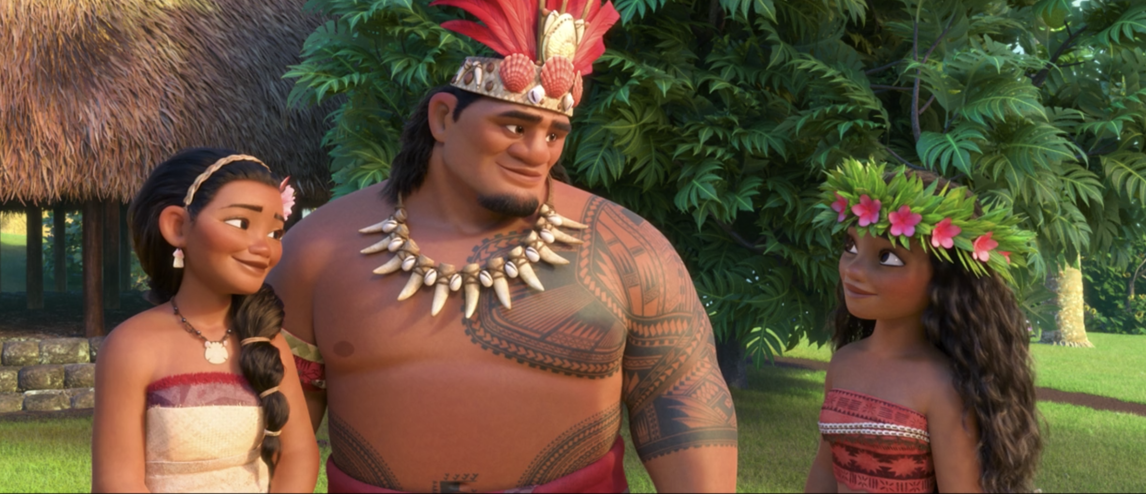 Moana grinning at her mom and dad