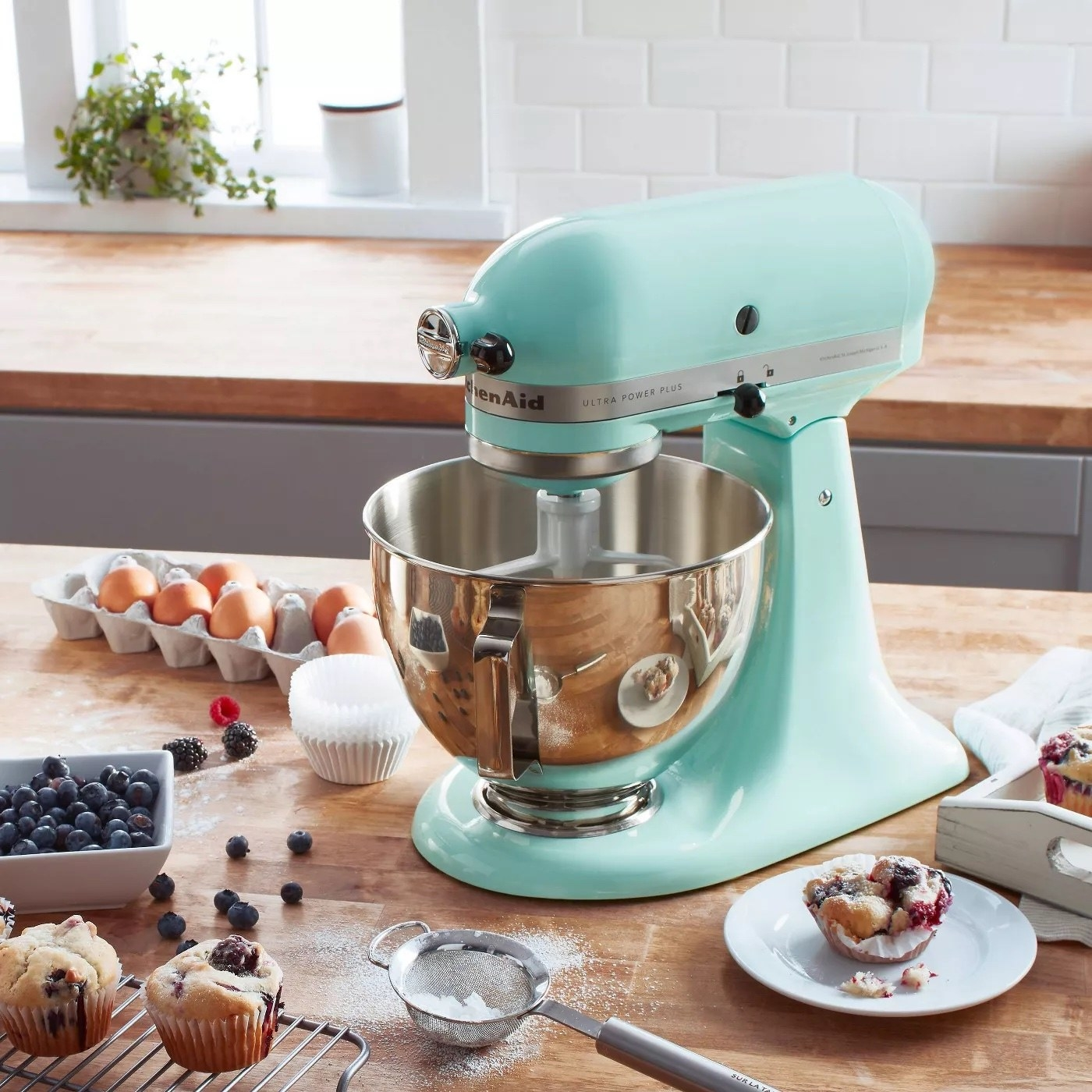 the mixer on a counter with baking ingredients