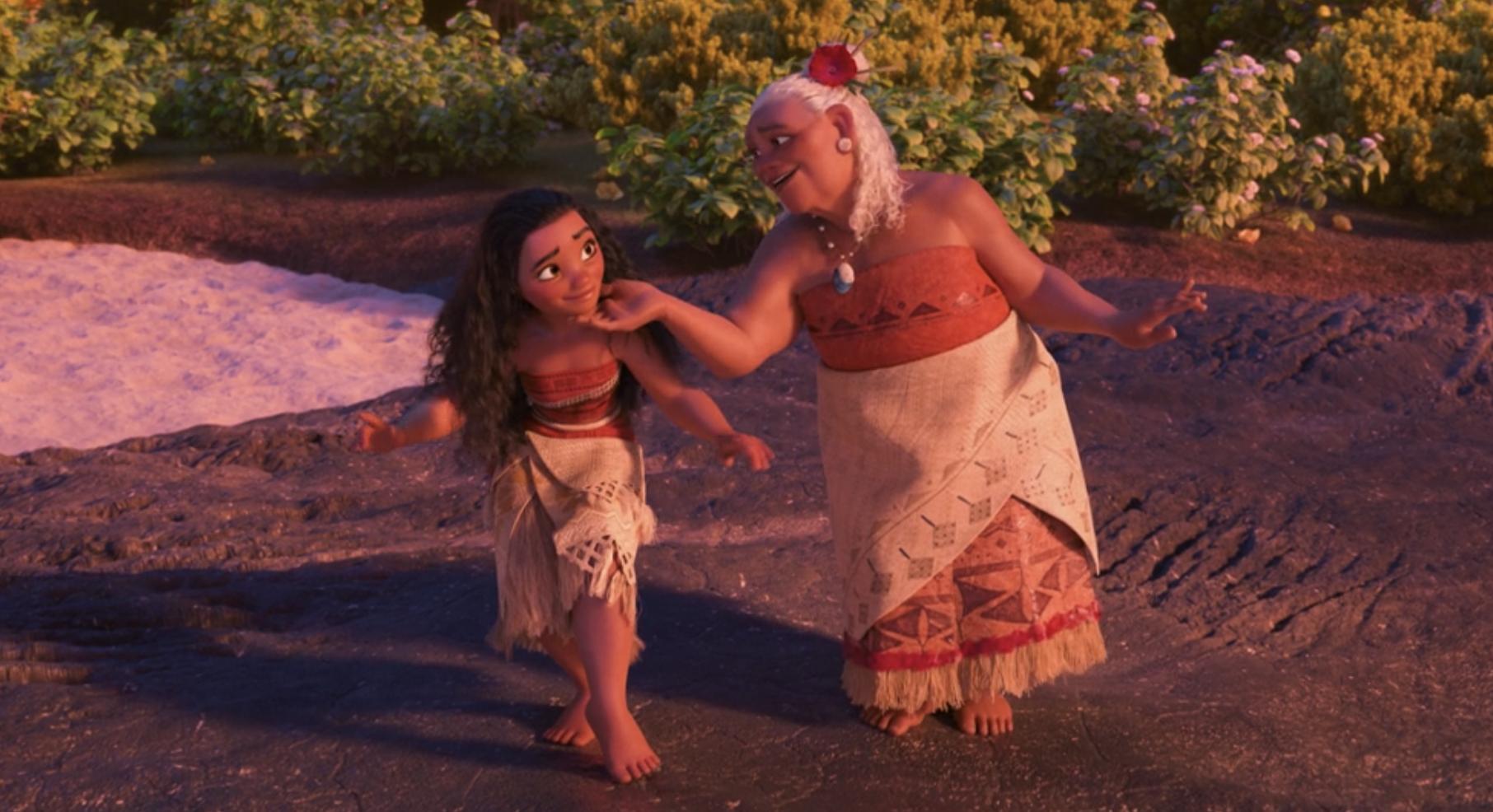 Moana dancing with her grandma, who is touching Moana's chin