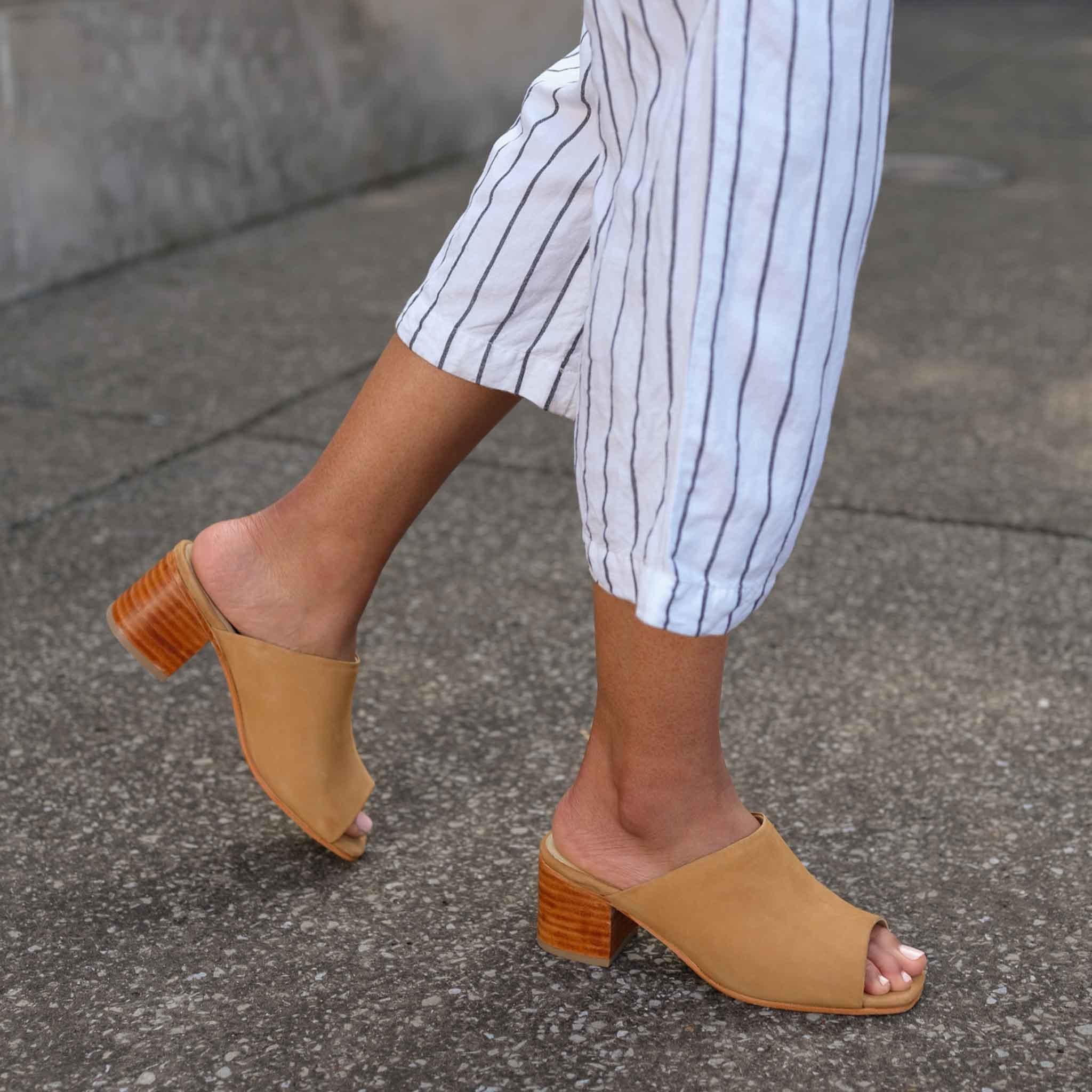 Model wearing beige open toed mules