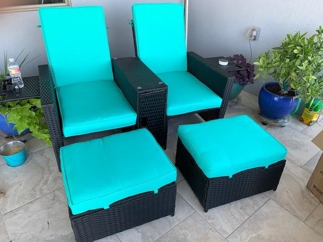 High back black rattan chairs with teal cushion and matching ottoman