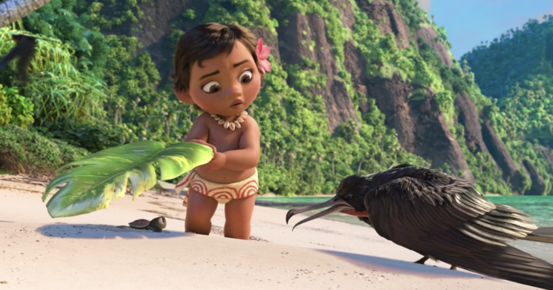 Baby Moana covering a baby turtle with a leaf and a bird looking angrily at them