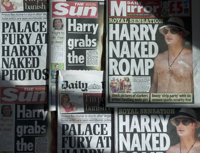 """Various UK newspaper front pages with headlines such as """"Harry Naked Romp"""" and """"Palace Fury at Harry Naked Photos"""""""