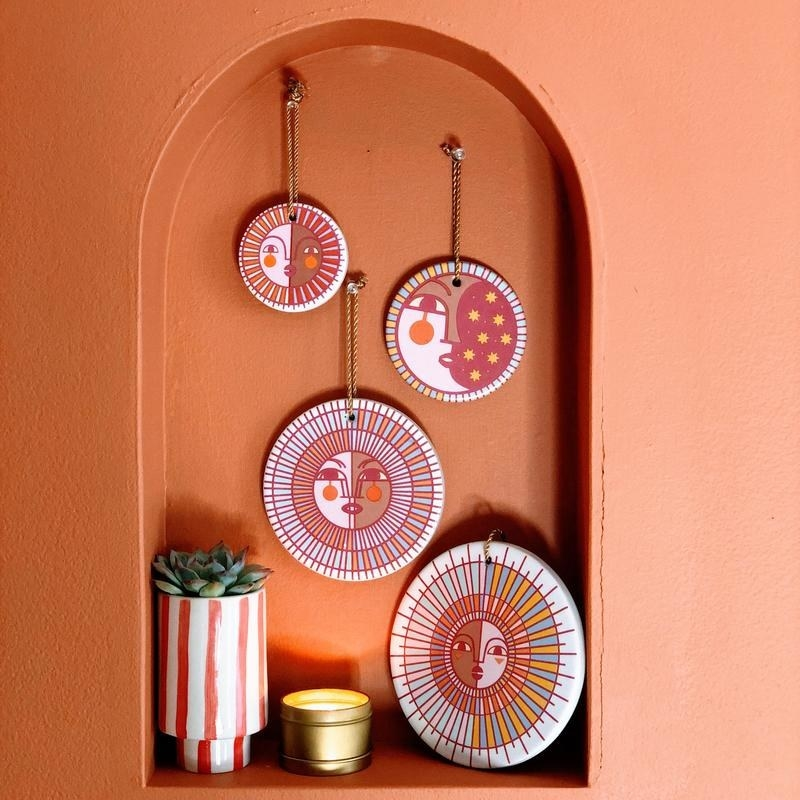 four-piece ceramic wall hanging set nestled in an orange nook