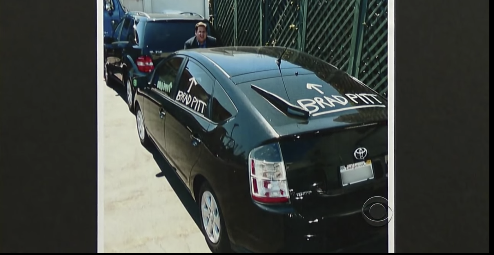 "Jonah Hill paints Brad Pitt's car with arrows pointing that say ""Brad Pitt"""