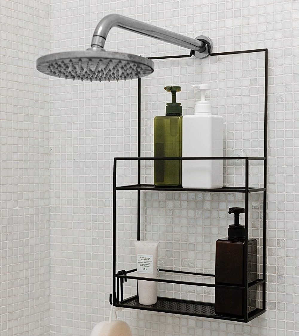 The shower caddy filled with products