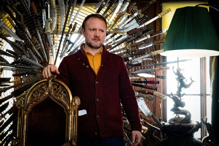 Rian standing by a chair adorned with a halo of knives
