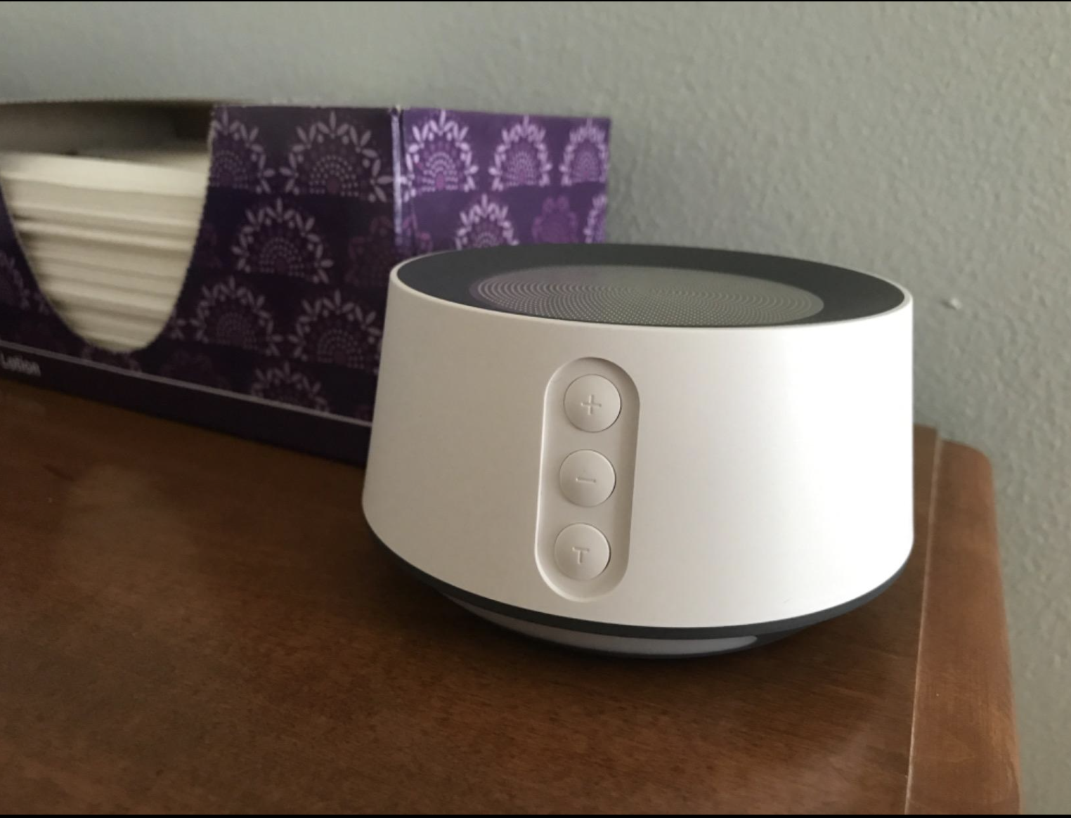 review photo of white small noise machine with three buttons in the front