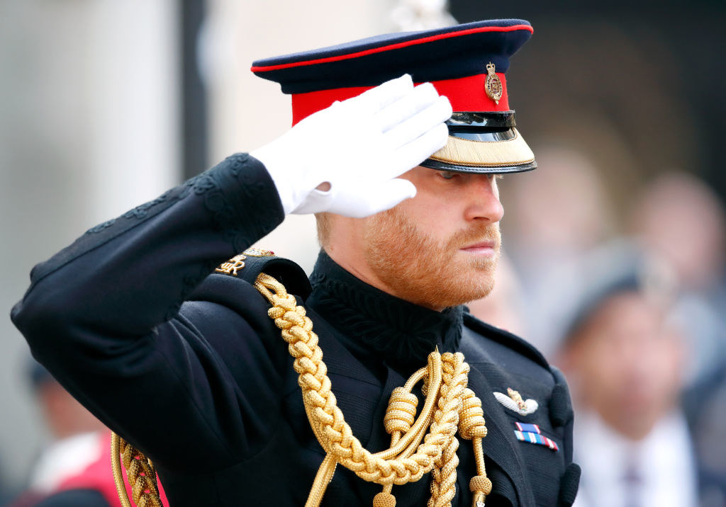 Prince Harry saluting in his military uniform