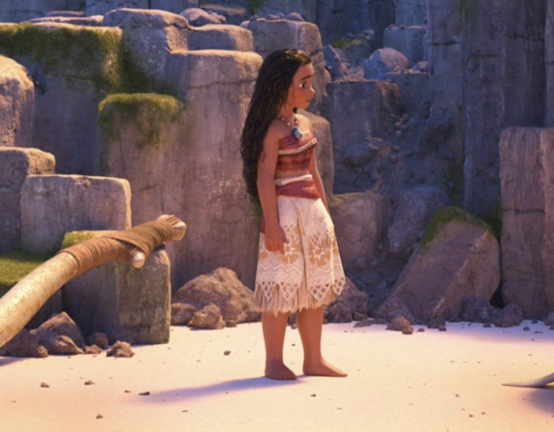 Moana standing on the sand
