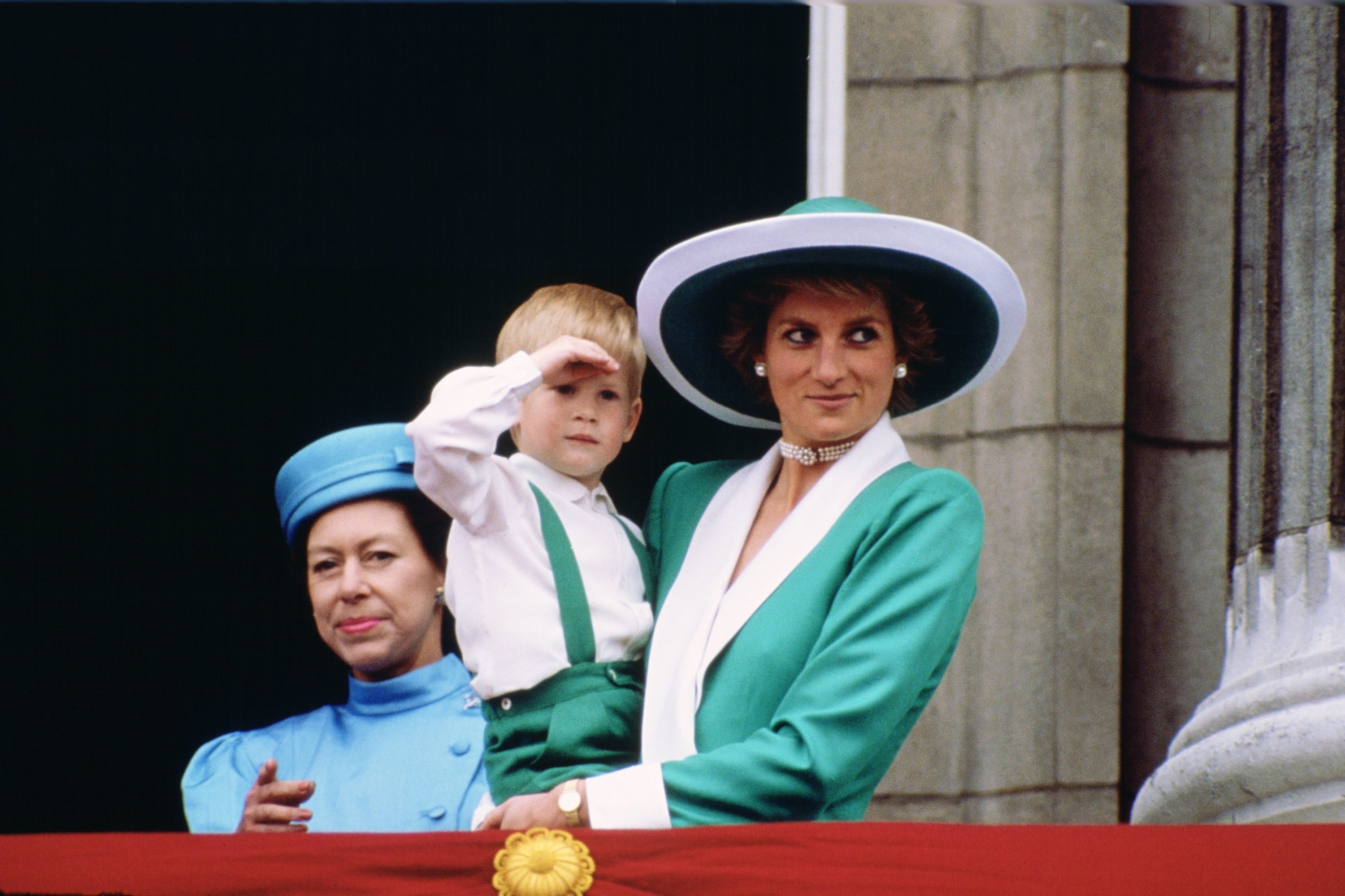 A very young Harry being held by Princess Diana