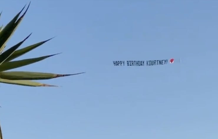 "A banner flies through the sky that says, ""Happy Birthday Kourtney"""